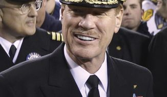 FILE - In this Dec. 8, 2012 file photo, U.S. Naval Academy Superintendent Vice Adm. Michael Miller poses for photographs after the Army-Navy NCAA college football game in Philadelphia. Miller is set to testify Friday as part of a hearing for a student charged in a sexual assault case. Lawyers for the student say political pressure influenced Miller, to pursue charges against the student, Joshua Tate of Nashville, Tenn. (AP Photo/Matt Rourke, File)