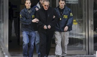 "FBI agents flank Vincent Asaro as they escort the reputed mobster from FBI offices in lower Manhattan, Thursday, Jan. 23, 2014, in New York. More than 30 years after the crime, Asaro was indicted in the $6 million Lufthansa heist at Kennedy Airport that was dramatized in the Martin Scorsese movie ""Goodfellas."" (AP Photo/Newsday, Charles Eckert) NYC LOCALS OUT"