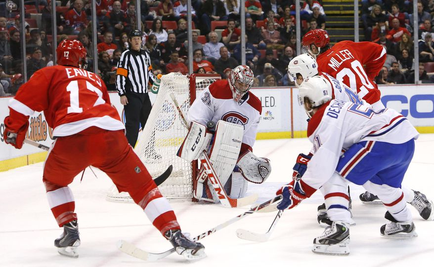 Montreal Canadiens goalie Carey Price (31) stops a shot by Detroit Red Wings' Patrick Eaves (17) in the second period of an NHL hockey game, Friday, Jan. 24, 2014, in Detroit. (AP Photo/Paul Sancya)
