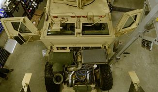 This photo taken on Monday, Jan. 13, 2014, shows an overview of a mine-resistant vehicle that is being fixed up for duty at the Utah Highway Patrol maintenance shop in Taylorsville, Utah. (AP Photo/The Salt Lake Tribune, Rick Egan)  DESERET NEWS OUT; LOCAL TV OUT; MAGS OUT