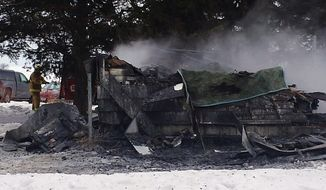 In this photo provided by the Fayette County, Iowa, Sheriff's Office is the scene of a fire that destroyed a house Friday, Jan. 24, 2014 in Arlington, Iowa, and killed at least five, according to  authorities. Officials said the property was damaged so badly it may be difficult for officials to collect enough evidence that could shed light on what started the fire. (AP Photo/Fayette County Sheriff's Office)