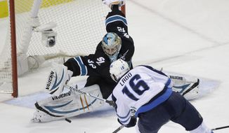 San Jose Sharks goalie Alex Stalock (32) stops a shot by Winnipeg Jets' Andrew Ladd (16) during the first period of an NHL hockey game Thursday, Jan. 23, 2014, in San Jose, Calif. (AP Photo/Marcio Jose Sanchez)