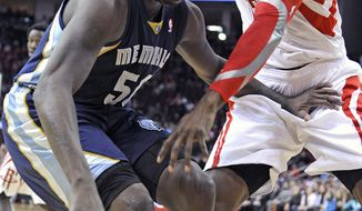 Memphis Grizzlies' Zach Randolph (50) holds off Houston Rockets' Dwight Howard, right, in the first half of an NBA basketball game Friday, Jan. 24, 2014, in Houston. (AP Photo/Pat Sullivan)