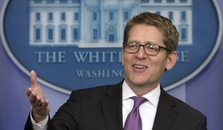 A clean-shaven White House press secretary Jay Carney jokes with reporters as he arrives for his daily news briefing at the White House in Washington, Friday, Jan. 24, 2014. During the briefing Carney discussed President Barack Obama's State of the Union Address, Iran, and other topics. (AP Photo/Carolyn Kaster)