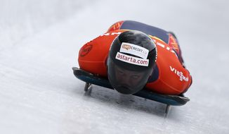 Martins Dukurs of Latvia speeds down the track during his first run of the men's Skeleton World Cup race in Koenigssee, southern Germany, on Saturday, Jan. 25, 2014. (AP Photo/Matthias Schrader)