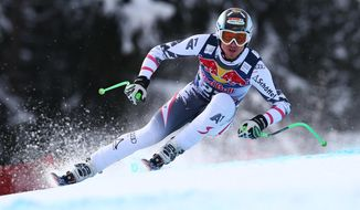 First placed Austria's Hannes Reichelt competes during an alpine ski, men's World Cup downhill, in Kitzbuehel, Austria, Saturday, Jan. 25, 2014. (AP Photo/Alessandro Trovati)