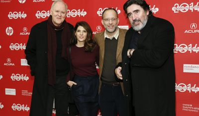 "File-This Jan. 18, 2014,  file photo shows Writer and director Ira Sachs, second right, poses with cast members from left to right, John Lithgow, Marisa Tomei, and Alfred Molina at the premiere of the film ""Love is Strange"" during the 2014 Sundance Film Festival, in Park City, Utah. (Photo by Danny Moloshok/Invision/AP)"
