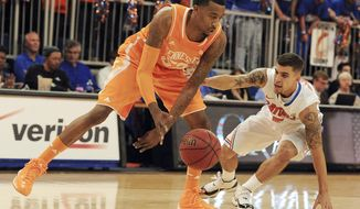 Tennessee guard Jordan McRae (52) moves the ball down court as Florida guard Scottie Wilbekin (5) tries to keep up during the first half of an NCAA college basketball game Saturday, Jan. 25, 2014, in Gainesville, Fla. (AP Photo/Phil Sandlin)