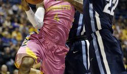 Marquette's Todd Mayo(4) drives to the basket against Villanova's JayVaughn Pinkston (22) during the first half of an NCAA college basketball game Saturday, Jan. 25, 2014, in Milwaukee. (AP Photo/Jeffrey Phelps)