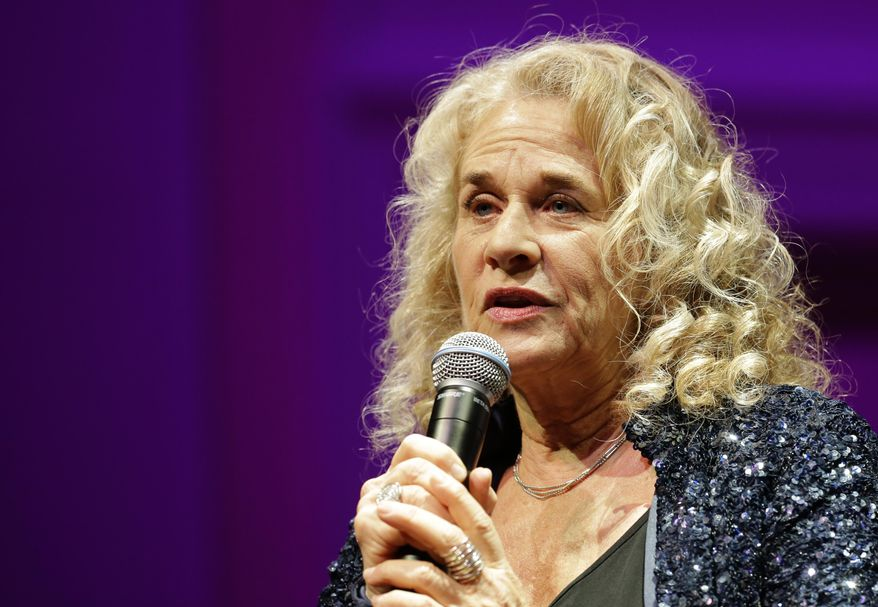 FILE - In this May 21, 2013 file photo, singer-songwriter Carole King, speaks during an event to honor her with the Gershwin Prize for Popular Song, at the Library of Congress, in Washington.  King is the 2014 MusiCares person of the year being honored on Friday, Jan. 24, 2014, in Los Angeles. The Dixie Chicks, Lady Gaga, Bette Midler and James Taylor are scheduled to perform. (AP Photo/Alex Brandon, File)