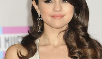 FILE - This Nov. 20, 2011 file photo shows Selena Gomez during arrivals to the 2011 American Music Awards, in Los Angeles. Los Angeles police have arrested a 19-year-old man on suspicion of trespassing at the home of singer-actress Selena Gomez. Officials said a family member called 911 Saturday Jan. 25, 2014, after seeing an intruder on the property in the Tarzana area.  (AP Photo/Chris Pizzello, file)