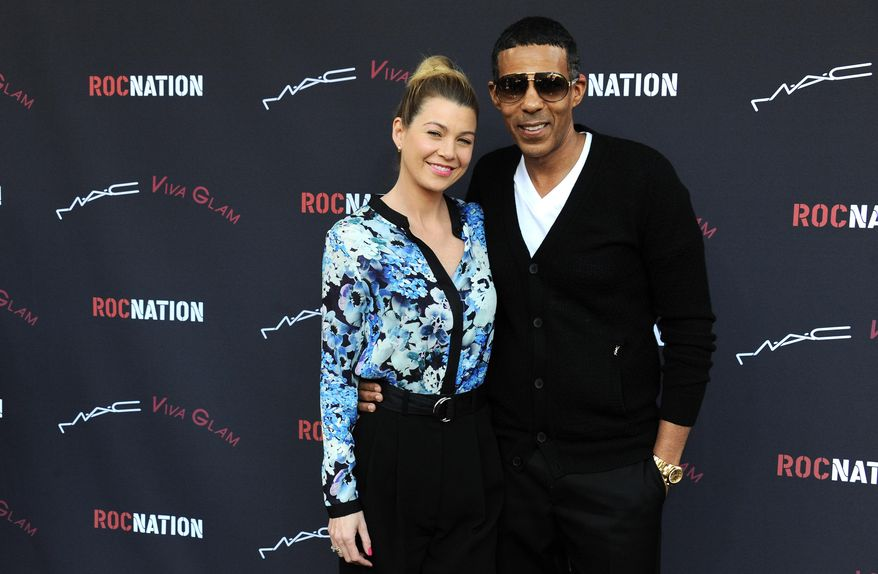 Ellen Pompeo, left, and her husband Chris Ivery arrive at the Roc Nation 2014 Pre-Grammy Brunch Celebration on Saturday, Jan. 25, 2014, in Los Angeles. (Photo by Jordan Strauss/Invision/AP)