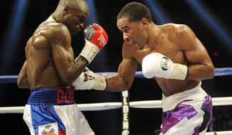 Lamont Peterson, right, punches Dierry Jean, of Canada, left, during the IBF Junior welterweight title boxing match, Saturday, Jan. 25, 2014, in Washington. Peterson won the match. (AP Photo/Nick Wass)