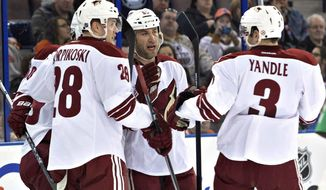 Phoenix Coyotes' Lauri Korpikoski (28), Derek Morris (53) and Keith Yandle (3) celebrate a goal against the Edmonton Oilers during the first period of an NHL hockey game Friday, Jan. 24, 2014, in Edmonton, Alberta. (AP Photo/The Canadian Press, Jason Franson)