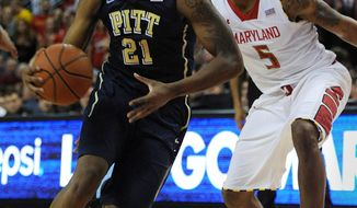 Pittsburgh's Lamar Patterson, left, drives the ball to the basket and past Maryland's Nick Faust in the second half of an NCAA college basketball game Saturday, Jan. 25, 2014, in College Park, Md. Pittsburgh won 83-79. (AP Photo/Gail Burton)