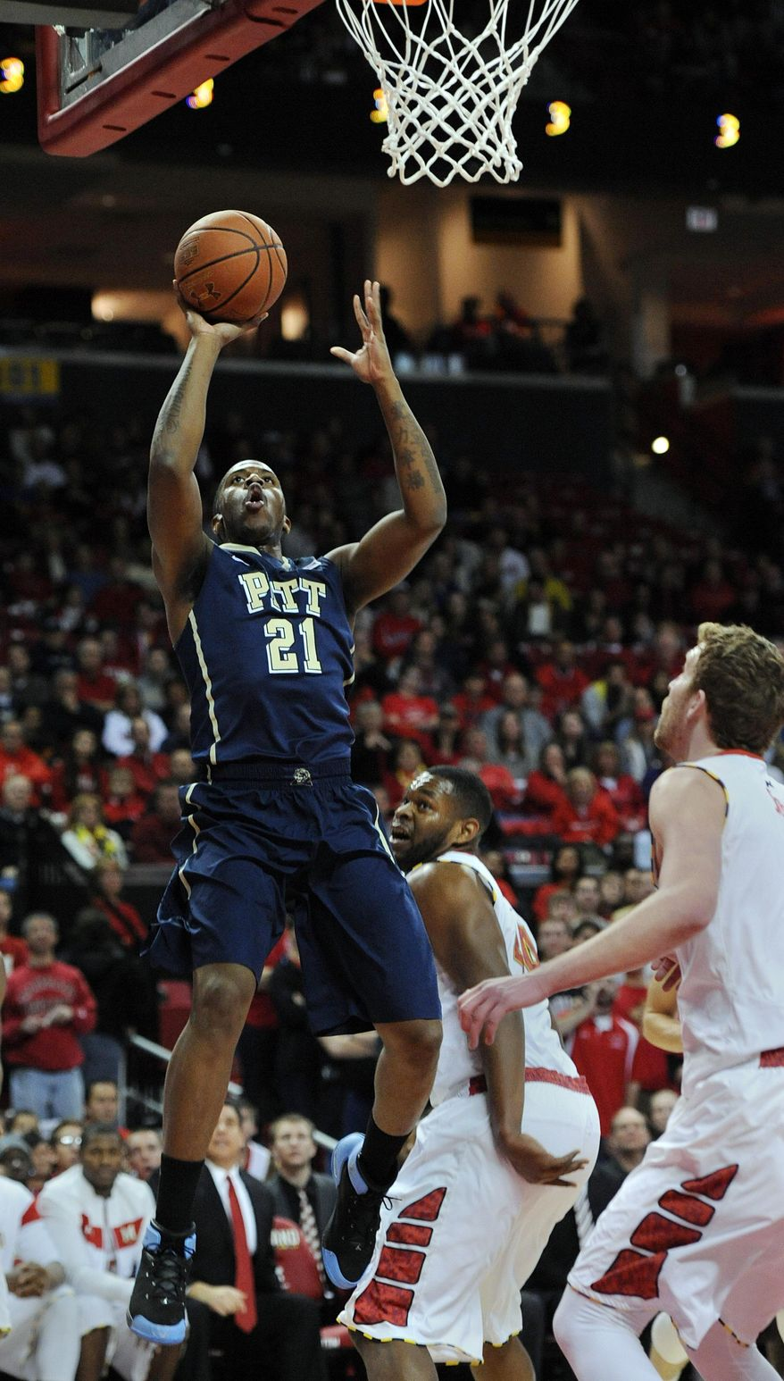 Pittsburgh's Lamar Patterson, left, shoots against Maryland in the first half of an NCAA college basketball game Saturday, Jan. 25, 2014, in College Park, Md. (AP Photo/Gail Burton)