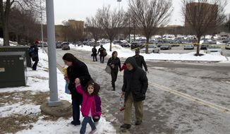 People are evacuated from the Mall in Columbia, Md., after a shooting at the mall on Saturday Jan. 25, 2014  in Howard County, Md. Police in Maryland say three people died Saturday in a shooting at a mall in suburban Baltimore, including the presumed gunman.  ( AP Photo/Jose Luis Magana)