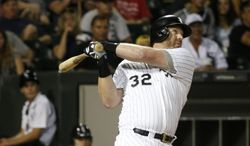 """FILE - In this Aug. 25, 2013 file photo, Chicago White Sox's Adam Dunn watches his two-run home run off Houston Astros starting pitcher Brett Oberholtzer during the sixth inning of a baseball game in Chicago. Dunn has a small role as a bartender in the film """"Dallas Buyers Club"""". White Sox manager Robin Ventura said it was surprising to see Dunn on the screen, Saturday, Jan. 25, 2014. (AP Photo/Charles Rex Arbogast, File)"""