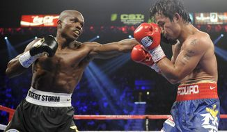 FILE - In this June 9, 2012, file photo, Timothy Bradley, left, from Palm Springs, Calif., lands a punch against Manny Pacquiao, from the Philippines, during their WBO world welterweight title fight in Las Vegas. Nearly two years after Bradley won in a disputed split decision, promoters announced Saturday, Jan. 25, 2014, that the two will fight again on April 12. (AP Photo/Chris Carlson, File)