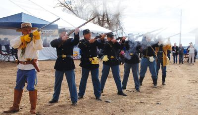 The Prescott Regulators conducted an 18-gun salute Wednesday, Jan. 22, 2014 to re-enact the welcome received by Gov. John Goodwin when he arrived at Del Rio Springs near current Chino Valley, Ariz., on Jan. 22, 1864. Goodwin was the first governor of Arizona.     (AP Photo/The Daily Courier, Joanna Dodder Nellans)