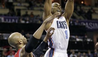Charlotte Bobcats' Gerald Henderson (9) dunks on Chicago Bulls' Taj Gibson during the first half of an NBA basketball game in Charlotte, N.C., Saturday, Jan. 25, 2014. (AP Photo/Chuck Burton)
