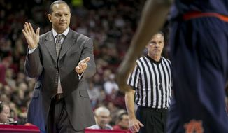 Auburn head coach Tony Barbee congratulates his defense on a blocked shot during the first half of an NCAA college basketball game against Arkansas on Saturday, Jan. 25, 2014, in Fayetteville, Ark. (AP Photo/Gareth Patterson)