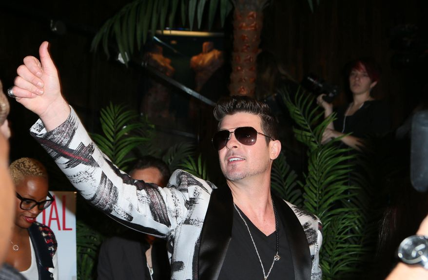 Robin Thicke  arrives Friday Jan. 24, 2014,  to the Los Angeles Confidential magazine, CBS Radio and the GRAMMY Museum at L.A. LIVE to celebrate The Grammys in Los Angeles. (Photo by Alexandra Wyman/Invision/AP))