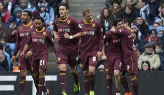 Watford's Fernando Forestieri, second right, celebrates with teammates after scoring against Manchester City during their English FA Cup fourth round soccer match at The City of Manchester Stadium, Manchester, England, Saturday, Jan. 25, 2014. (AP Photo/Jon Super)