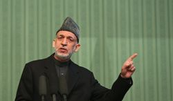 Afghan President Hamid Karzai speaks during a press conference at the presidential palace in Kabul, Afghanistan, Saturday, Jan. 25, 2014. Karzai said he will not sign a security pact with the United States unless Washington and Pakistan launch a peace process with Taliban insurgents. (AP Photo/Massoud Hossaini)