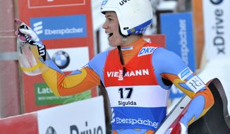 United States' Kate Hansen reacts after winning the women's  race at the Luge World Cup event in Sigulda, Latvia, Saturday, Jan. 25, 2014. Gough placed second. (AP Photo/Roman Koksarov, F64)