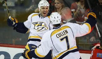 Nashville Predators' Eric Nystrom, left, celebrates his fourth goal with teammate Matt Cullen during third period NHL hockey action against the Calgary Flames in Calgary, Alberta, Friday, Jan. 24, 2014. The Calgary Flames beat the Nashville Predators 5-4 in a shootout. (AP Photo/The Canadian Press, Jeff McIntosh)