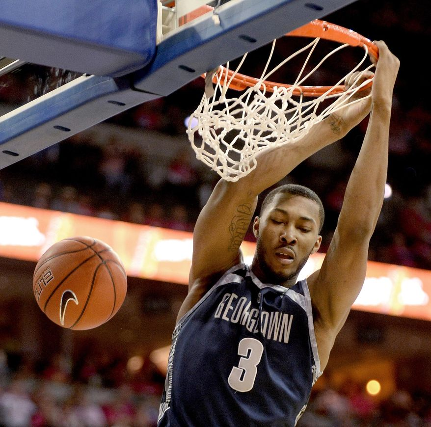 Georgetown forward Mikael Hopkins dunks during the first half of an NCAA college basketball game in Omaha, Neb., Saturday, Jan. 25, 2014. (AP Photo/Francis Gardler)