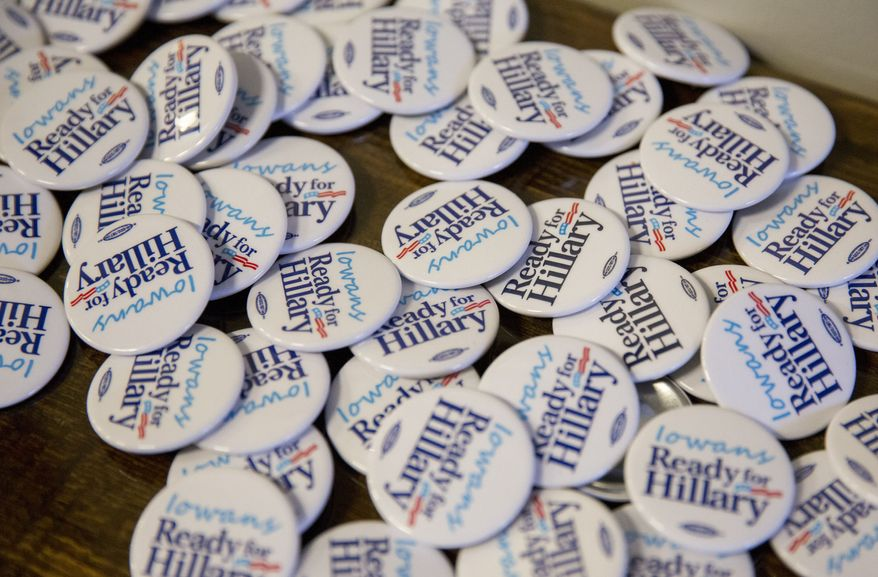 Campaign buttons are ready for distribution at an Iowa kickoff event for the national Ready for Hillary group led by Craig Smith, senior adviser to the Ready for Hillary group, in Des Moines, Iowa, Saturday, Jan. 25, 2014. Ready for Hillary is a so-called super PAC building a national network to benefit Clinton if she decides to seek the presidency in 2016. The gathering of Iowa Democrats including the state chairs of both Clinton and President Barack Obama's 2008 campaigns. (AP Photo/Justin Hayworth)