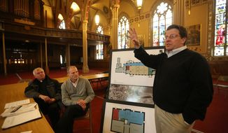 ADVANCE FOR WEEKEND EDITIONS JAN. 25-26 - In this Jan. 20, 2014 photo, John Gronen, owner of Gronen Properties, discusses plan for the St. Mary Church campus in Dubuque, Iowa. Also pictured are Monsignor Tom Toale, left, vicar general for the Archdiocese of Dubuque, and John Schmidt, chief financial officer for A.Y. McDonald. Plans are coalescing for the rebirth of the area known as the St. Mary Church Campus, bordered by White and Jackson streets and 15th and 16th streets. Venerable old buildings, each more than a century old, would be restored, renovated and repurposed into a dynamic mix of living, working, learning and playing spaces surrounded by lush green spaces. (AP Photo/The Telegraph Herald, Jessica Reilly)