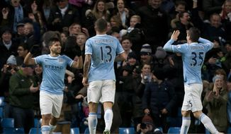 Manchester City's Sergio Aguero, left, celebrates with teammates after scoring the third of his 3 goals past Watford's goalkeeper Jonathan Bond during their English FA Cup fourth round soccer match at The City of Manchester Stadium, Manchester, England, Saturday, Jan. 25, 2014. (AP Photo/Jon Super)