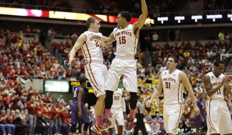 Iowa State guard Matt Thomas, left, celebrates with teammate Naz Long (15) after making a 3-point basket during the first half of an NCAA college basketball game against Kansas State, Saturday, Jan. 25, 2014, in Ames, Iowa. (AP Photo/Charlie Neibergall)