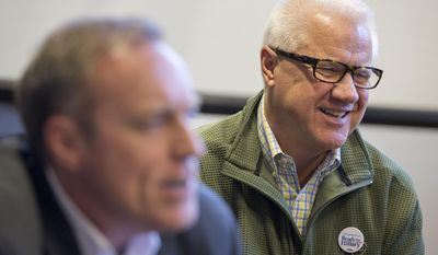 Jerry Crawford, right, a Des Moines attorney and long time Democratic political activist, listens as Craig Smith, the national chairman of the Ready for Hillary group, speaks to members of the media during a gathering of Iowa Democrats including the state chairs of both Clinton and President Barack Obama's 2008 campaigns in Des Moines, Iowa, Saturday, Jan. 25, 2014. (AP Photo/Justin Hayworth)