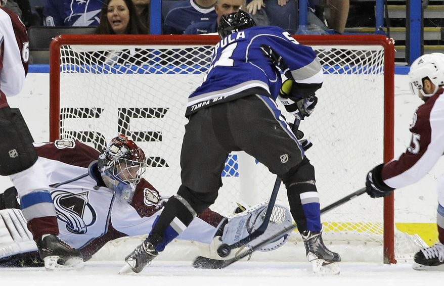 Colorado Avalanche goalie Sami Aittokallio (30), of Finland, dives to stop a shot by Tampa Bay Lightning center Valtteri Filppula (51), also of Finland, during the first period of an NHL hockey game Saturday, Jan. 25, 2014, in Tampa, Fla. (AP Photo/Chris O'Meara)