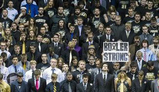 A moment of silence was recognized by the crowd to honor Andrew Boldt, the 21-year-old teaching assistant who was killed at Purdue University on Tuesday, during pre-game activities of an NCAA college basketball game, Saturday, Jan. 25, 2014, in West Lafayette, Ind. Students wore dress ties in memory of their fellow student. (AP Photo/Doug McSchooler)