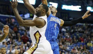 New Orleans Pelicans point guard Tyreke Evans (1) drives past Orlando Magic shooting guard Doron Lamb (1) in the first half of an NBA basketball game in New Orleans, Sunday, Jan. 26, 2014. (AP Photo/Bill Haber)