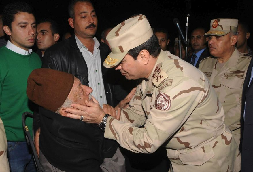 In this undated photo released by the Egyptian Defense Ministry, Defense Minister Gen. Abdel-Fattah el-Sissi consoles a man at a funeral for several military personnel who were killed when a    helicopter crashed in the Sinai Peninsula, at an undisclosed location in Egypt. Egypt's military spokesman, Col. Ahmed Mohammed Ali said that an Air Force helicopter crashed near the village of el-Kharouba in the northern Sinai Peninsula early Saturday, where troops are battling Islamic militants. An al-Qaida-inspired group based in the Sinai Peninsula has claimed responsibility for bringing down an Egyptian military helicopter in the lawless desert region. (AP Photo/Egyptian Defense Ministry via Facebook)