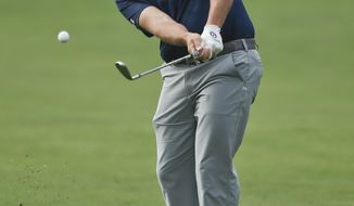 Scott Stallings hits to the sixth green of the South Course at Torrey Pines during the final round of the Farmers Insurance Open golf tournament Sunday, Jan. 26, 2014, in San Diego. (AP Photo/Lenny Ignelzi)