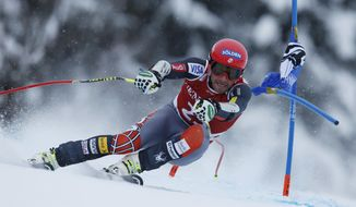 Bode Miller of United States speeds down the course to win an alpine ski men's World Cup Super G in Kitzbuehel, Austria, Saunday, Jan. 26, 2014. (AP Photo/Shinichiro Tanaka)