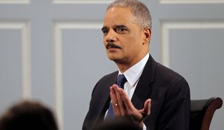Attorney General Eric H. Holder Jr. will issue guidance giving wiggle room to banks that work with marijuana clients in violation of federal banking laws. (ASSOCIATED PRESS)