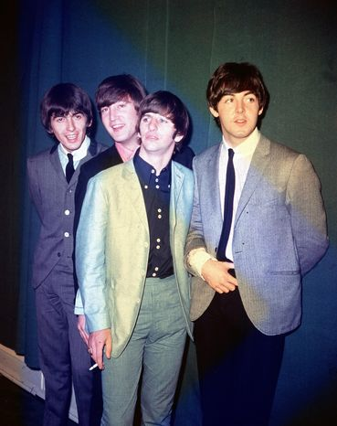 FILE - This 1964 file photo shows the British rock and roll group, the Beatles, from left, George Harrison, John Lennon, Ringo Starr and Paul McCartney, during their first U.S. tour. McCartney and Starr will attend the Recording Academy's Special Merit Awards ceremony, on Saturday, Jan. 25, 2014, where the Beatles will be honored with a lifetime achievement award, in Los Angeles. (AP Photo, File)