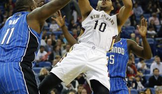 New Orleans Pelicans shooting guard Eric Gordon (10) shoots over Orlando Magic power forward Glen Davis (11) in the first half of an NBA basketball game in New Orleans, Sunday, Jan. 26, 2014. (AP Photo/Bill Haber)
