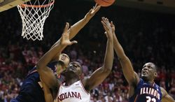 Indiana's Noah Vonleh (1) battles of a rebound against Illinois' Malcolm Hill (21) and Nnanna Egwu (32) during the first half of an NCAA college basketball game, Sunday, Jan. 26, 2014, in Bloomington, Ind. (AP Photo/Darron Cummings)