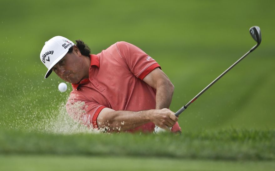 Pat Perez shoots the bunker on the sixth hole of the South Course  at Torrey Pines during the final round of the Farmers Insurance Open golf tournament Sunday, Jan. 26, 2014, in San Diego. (AP Photo/Lenny Ignelzi)