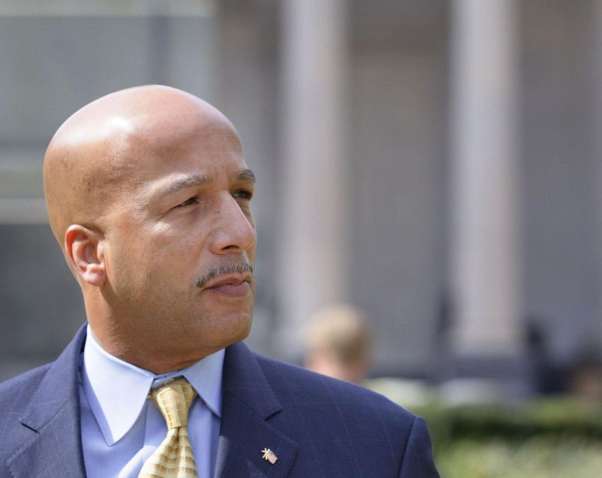 FILE - In a Wednesday, Feb. 20, 2013 file photo, former New Orleans Mayor C. Ray Nagin walks past Gallier Hall, the old New Orleans City Hall as he arrives at the Hale Boggs Federal Building and United States District Courthouse to appear in federal court for an arraignment on public corruption charges in New Orleans. Nagin, who led the city during its darkest days after Hurricane Katrina, will be thrust back into the spotlight Monday, Jan. 27, 2013 when he goes on trial in a corruption case that mushroomed at the end of his eight-year tenure. (AP Photo/Matthew Hinton, File)