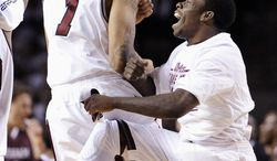 Massachusetts' Maxie Esho, left, and Chaz Williams react during the second half of an NCAA college basketball game against Fordham, Sunday, Jan. 26, 2014, in Amherst, Mass. Massachusetts won 90-52.  (AP Photo/Jessica Hill)